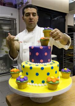 Buddy Valastro decorates a bright, spotted birthday cake at Carlo's Bake Shop in Hoboken, N.J.