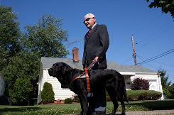 Max Edelman walks with his third guide dog, Tobin. Edelman, 86, was blinded as a young man in a Nazi concentration camp, where earlier he had witnessed another prisoner killed for sport by a Nazi commandant's massive German shepherd.