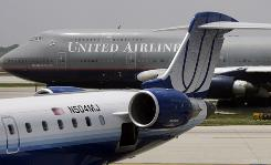 Aircraft stack up on the tarmac outside O'Hare International Airport in Chicago, Ill. Congress may consider legislation that would allow passengers to de-plane badly delayed flights.