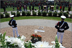 Members of Virginia Tech's Corps of Cadets guard a ceremonial candle that honors the victims of the mass shooting on the Blacksburg, Va., campus in April 2007.