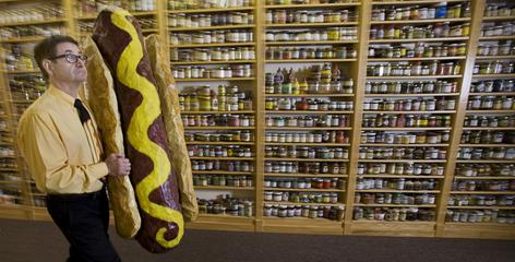 Barry Levenson, proprietor of the Mustard Museum, prepares Wednesday for its final National Mustard Day celebration in Mount Horeb, Wis., on Saturday. Levenson is moving the museum 18 miles away this fall.