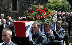 WWI veteran Henry Allingham's coffin is carried from St. Nicholas Church in Brighton, England Thursday after his funeral.