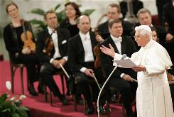 Pope Benedict XVI speaks after a concert performed by Germany's Stuttgart Radiophonic Orchestra for his 80th birthday at the Vatican's Paul VI hall April 16, 2007. The pope's upcoming album will feature himself, as well as classical music by the Royal Philharmonic Orchestra.