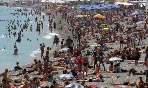 Vacationers and tourists sunbathe Thursday on the beach of Nice in southeastern France as summer vacation continues on the French Riviera.