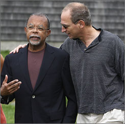 Harvard professor Henry Louis Gates, Jr., walks with fellow Yale University graduate Tom Milch as Gates arrives at the Martha's Vineyard book festival.
