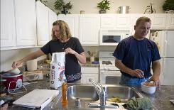 Lynn Flitton and her husband, Mark, prepare dinner at their home in Mountain View, Calif.