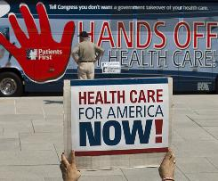 Dueling messages were on display prior to a rally in Lincoln, Neb., in opposition to Democratic-led efforts to overhaul the nation's health care system.