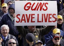 Gun owners rally at the Illinois State Capitol for legislation that would let them carry concealed weapons. In response to the Obama administration and the recession, more people have sought the permits.