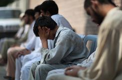 Boys who were allegedly kidnapped by Taliban militants, conceal their identities in Mingora, Pakistan on Monday. The army says it has recovered 20 boys from the Swat Valley and nearby areas who were being trained by the Taliban to become informants, fighters or suicide bombers.