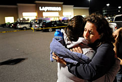 Nancy Smith, right, hugs her daughter, Tracey, outside of the LA Fitness on Tuesday in Bridgeville, Pa., where a gunman opened fire in an aerobics class.