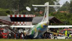 A Bangkok Airways plane is seen after it skidded off the runway while attempting to land during heavy rains on Samui island in southern Thailand on Tuesday. The domestic airliner crashed into an old air traffic control tower after landing, killing the pilot, a government official said.