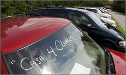"Cars marked for the government's ""cash-for-clunkers"" program sit along a road at the Darrell Waltrip Honda dealership in Franklin, Tenn."