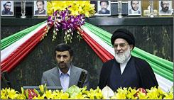 Iran's President Mahmoud Ahmadinejad, left, reads the oath of office as Judiciary Chief Mahmoud Hashemi Shahroudi looks on during Ahmadinejad's swearing-in ceremony in Tehran.