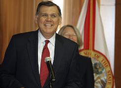 Republican Sen. Mel Martinez announces his intention to resign from the Senate during a news conference, in Orlando, Fla. on Friday. Martinez is leaving the seat more than a year before his term ends.