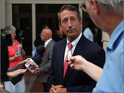 Gov. Mark Sanford talks to reporters outside of the Beaufort County Courthouse. 