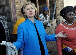 Secretary of State Hillary Rodham Clinton visits a house under construction in Khayelitsha, South Africa, on Saturday.