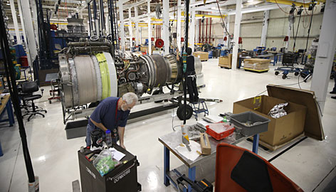 Jet engine mechanics work on TF33 aircraft engines at Tinker Aerospace Complex on Friday in Oklahoma City. Oklahoma City has the second-lowest unemployment rate in the nation among large metro areas.