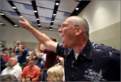 Randy Hook, 50, of Hopewell, Pa., yells at Sen. Arlen Specter, D-Pa., during a town hall meeting on health care in a Penn State University ballroom in State College, Pa.