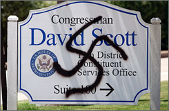 The staff of U.S. Rep. David Scott, D-Ga., arrived at his Smyrna, Ga., office Tuesday to find a swastika painted outside. The FBI is now investigating.