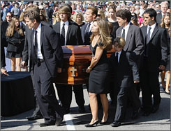 Members of the Kennedy family, including California first lady Maria Shriver, foreground, and her husband, California Gov. Arnold Schwarzenegger, carry the coffin of Eunice Kennedy Shriver Friday into Saint Francis Xavier Catholic Church in the Hyannis section of Barnstable, Mass. The elder Shriver, mother of Maria Shriver, died Tuesday at age 88.