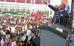 Bishop T.D. Jakes asks the crowd to make some noise during the opening event of MegaFest at International Plaza in Atlanta.