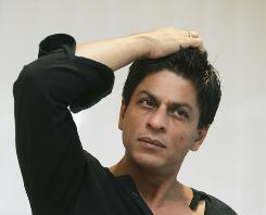 Bollywood actor Shah Rukh Khan, seen here at his Mumbai residence, was detained for at Newark airport and grilled for two hours before being let go by U.S. authorities.