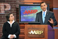 President Obama addresses a town hall-style health care event in Washington on July 28, as AARP's president, Jennie Chin Hansen, listens. A spokesman for AARP said Monday the group had lost 60,000 members for its support of health care overhaul.