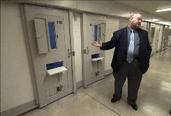 Warden Thomas Birkett shows a cellblock at Standish Maximum Correctional Facility. Corrections officials spruced up the facility and welcomed a delegation from California last month.