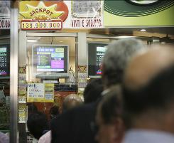 Tough odds haven't dampened enthusiasm for buying tickets for Italy's SuperEnalotto. People queue Tuesday in Milan for a chance to win the jackpot.