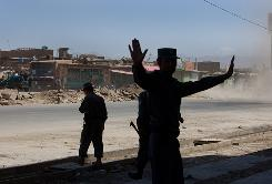 Afghan National Police and Afghan National Army secure the site of a bank where gunmen attacked on Wednesday in Kabul, Afghanistan.