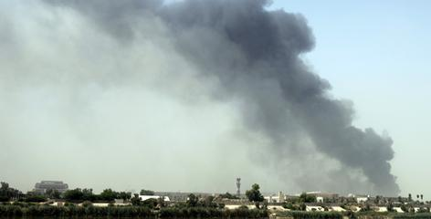 Smoke rises over Baghdad on Wednesday after a massive bombing attack on the foreign ministry.