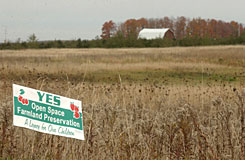 A farm in Acme Township north of Traverse City, Mich., sports a sign supporting an upcoming open space initiative to preserve land from development.