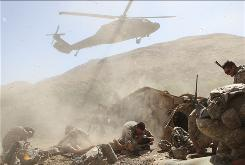A helicopter lands Wednesday in Afghanistan to transport wounded soldiers after their vehicle was hit by a roadside bomb in Wardak province.