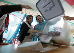 Afghans count ballot papers after closing of polling stations on Thursday in Kabul, Afghanistan, for the presidential election.