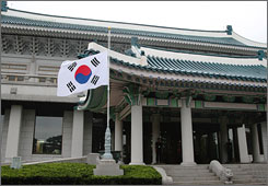 South Korean President Lee Myung-bak held talks with the North Korean delegation at his office on Sunday in Seoul.