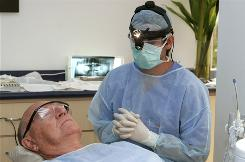 Costa Rican Dr. Luis Obando prepares to perform a root canal on Bill Jones, of Dallas, Texas, at Meza Dental Care in San Jose, Costa Rica. Jones said he elected to have the surgery in Costa Rica because he was able to save substantially compared to what he would have had to pay in the USA.