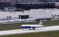 A United Airlines jet lands on the new runway at O'Hare International Airport in Chicago in November. Last year through June, only 61% of flights arrived on time at O'Hare. This year, 78% arrived within 15 minutes of their scheduled arrival times. Also, the new runway that opened last fall at O'Hare  a major choke point in the aviation system  had a big impact on air-traffic congestion.
