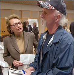 National Committee to Preserve Social Security and Medicare chief Barbara Kennelly talks with Larry McFarlin of Fort Smith, Ark., after a town hall meeting on Social Security in Little Rock in 2005.