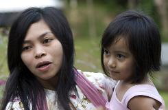 Muslim model Kartika Sari Dewi Shukarno, 32, shown here on Monday with her daughter, will be caned for drinking alcohol.