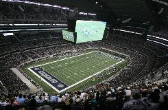 A punt hit the gigantic four-sided video board in the first game played at the new Dallas Cowboys Stadium.