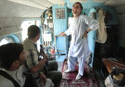 Underdog candidate Abdullah Abdullah  an eye doctor turned rebel turned diplomat  travels to a campaign stop before the Aug. 20 presidential election in Afghanistan.