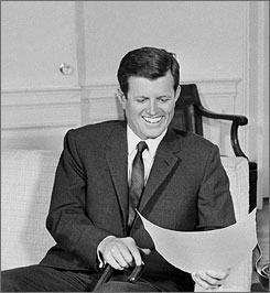 Sen. Edward Kennedy, D-Mass., laughs as he visits with President Johnson at the White House in January 1965.