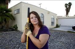 Anya Sanko works in the yard of her new home, which was a foreclosure purchase, on the east side of Las Vegas.