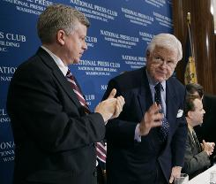 Sen. Edward M. Kennedy receives applauds after his speech at the National Press Club in Washington in January 2007. At left is Brian Hart from Bedford, Mass., whose son John was killed in 2003 while serving in Iraq.