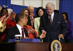 President Obama presents a pen to Sen. Edward Kennedy on April 21 after signing the Edward M. Kennedy Serve America Act.