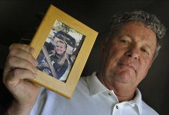 Carl Probyn, Jaycee Lee Dugard's stepfather, holds a picture of her Thursday. Probyn told ABC News he had given up hope.
