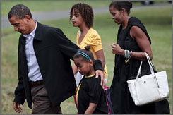 President Obama and his family walk from Marine One on the South Lawn of the White House on Sunday as they return from vacation in Massachusetts.