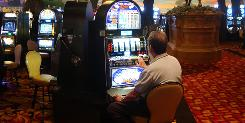 Patrons play the penny slot machines in July at Charles Town Races & Slots in Charles Town, W.Va. The once-derided games have enjoyed a recession resurgence.