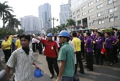 Workers are evacuated outside their office buildings following an earthquake on Wednesday in Jakarta, Indonesia.