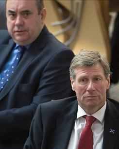 Scottish Justice Secretary Kenny MacAskill, right, is pictured with First Minister Alex Salmond as he answers questions from members of Parliament in Edinburgh on Wednesday. Britain did not want the Lockerbie bomber to die in prison, Foreign Secretary David Miliband said.